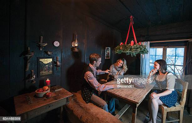 Three friends spending time together in a farmhouse room at Advent
