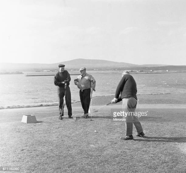 Three friends tee off for a round of golf on a very windy Fort Island Golf links Hotel on the Isle of Man course 7th May 1954
