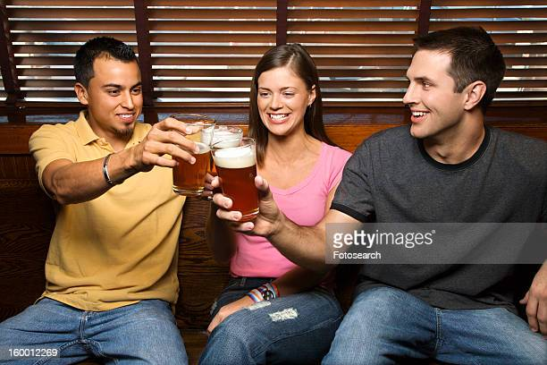 Three Friends Toasting With Beers