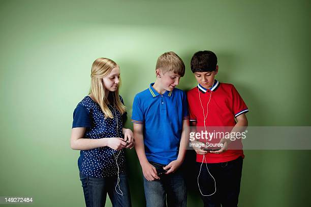 Three friends with mp3 players