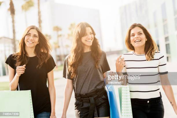 Three friends with shopping bags
