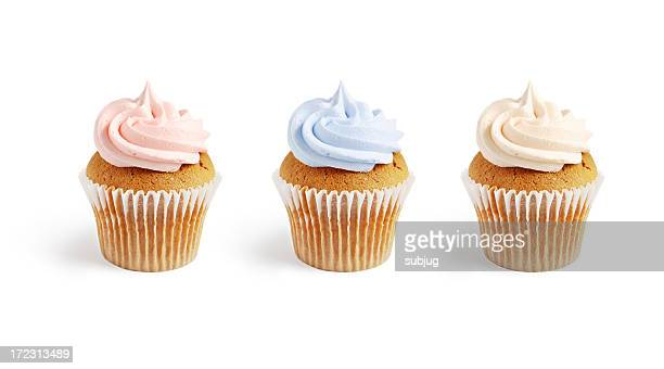 Three frosted vanilla cupcakes with pink and blue frosting