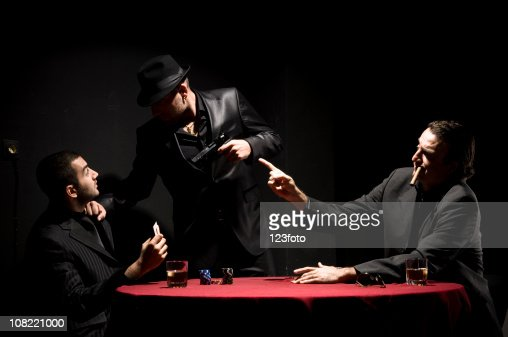 Three Gangster Men Playing Cards While Smoking And
