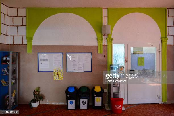 Three garbage container stand in the Muslim cultural center and mosque as Aydan Ozoguz German Federal Commissioner for Immigration Refugees and...