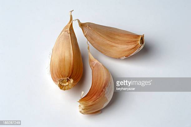 three garlic cloves - garlic clove stock pictures, royalty-free photos & images