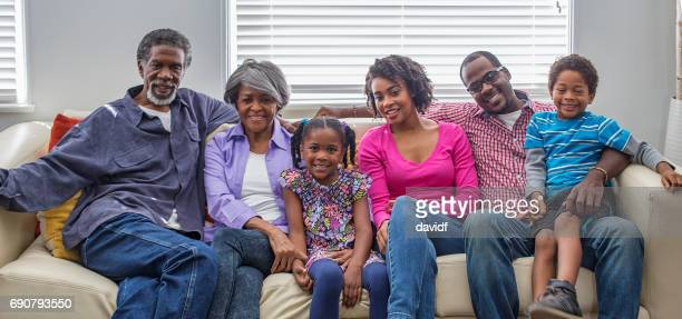 three generation african american family relaxing at home - multi generation family photos stock pictures, royalty-free photos & images