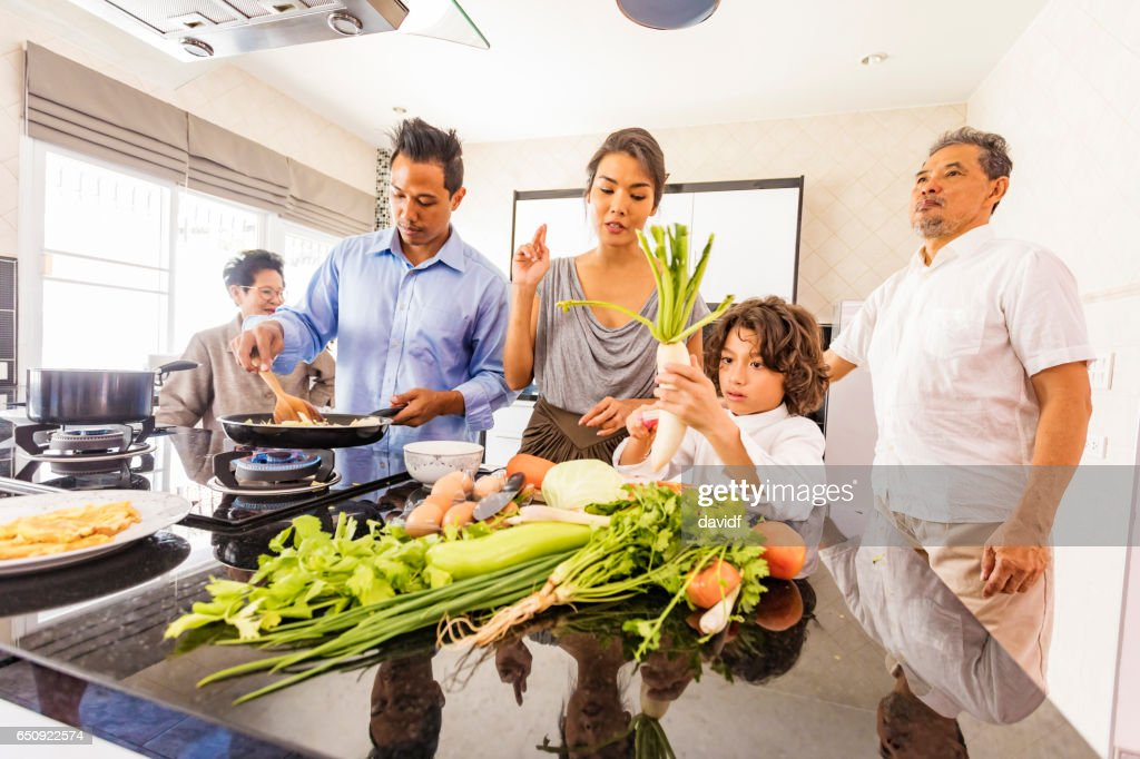 Three Generation Asian Family Cooking Healthy Food Together : Stock Photo