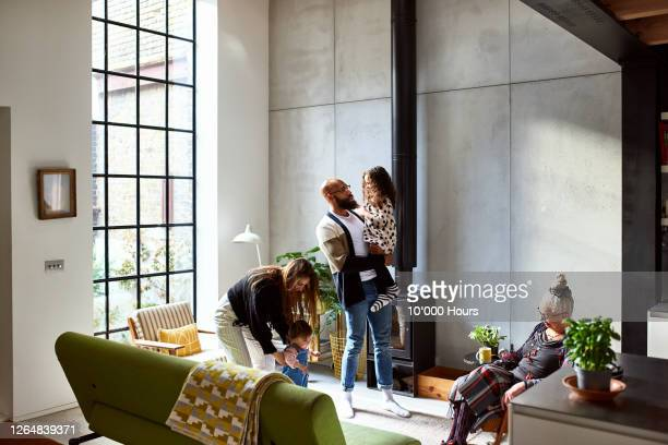 three generation family at home relaxing - embracing stock pictures, royalty-free photos & images