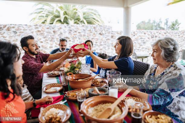three generation family at lunch - mexican culture stock pictures, royalty-free photos & images