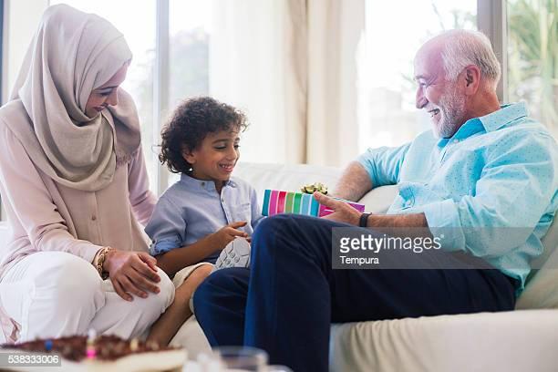 Three generation family celebrating a birthday in Dubai.