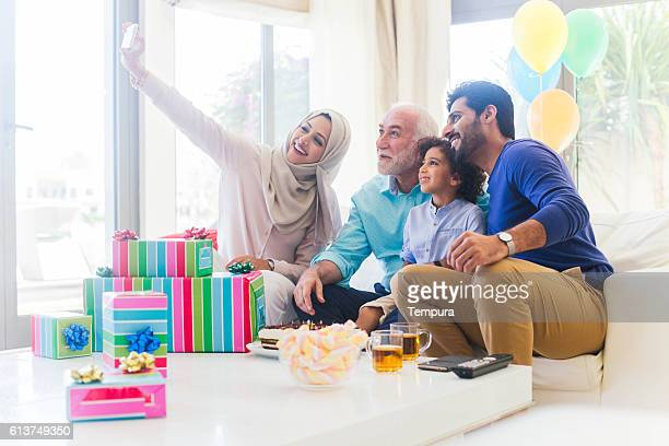 Three generation family celebrating a birthday in Dubai.