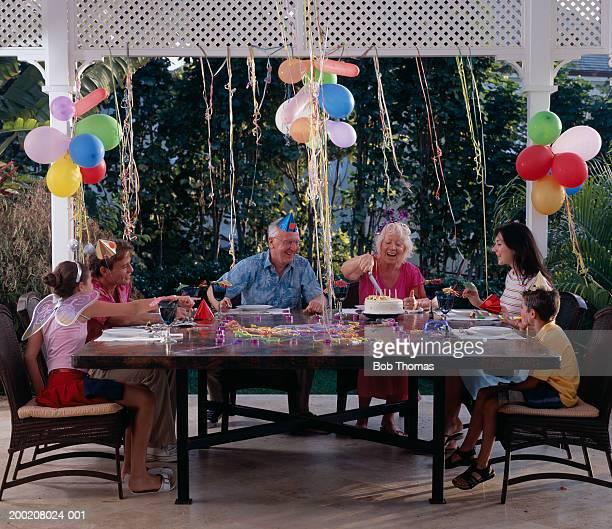 Three generation family celebrating at birthday party