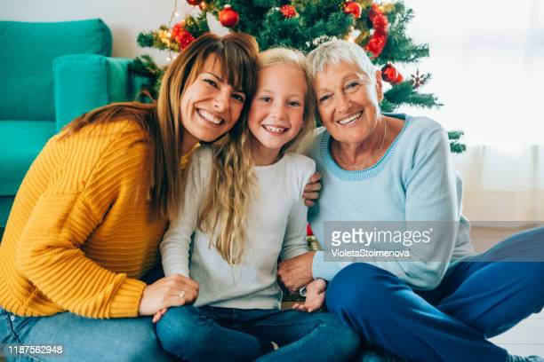 three generation family christmas portrait. - mixed age range stock pictures, royalty-free photos & images