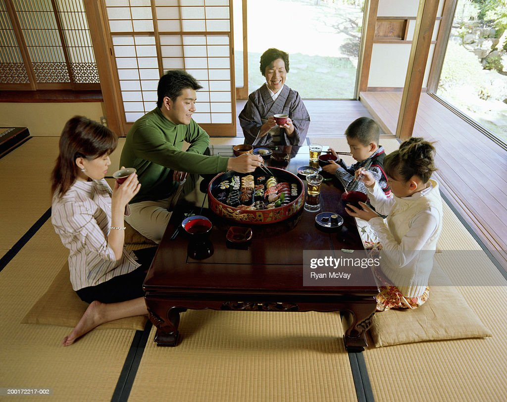Three generation family eating sushi, elevated view : Stock Photo