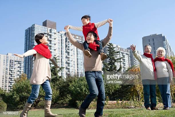 Three Generation Family Enjoying a Park in Autumn