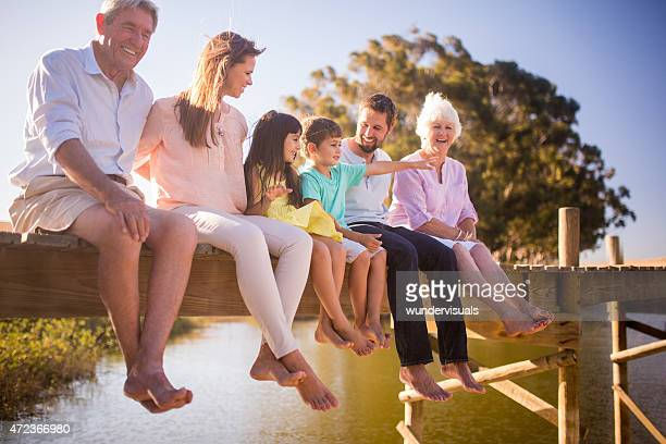 three generation family enjoying a summer vacation together - multigenerational family stock photos and pictures