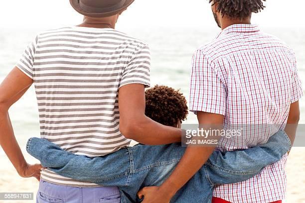 Three generation family enjoying beach