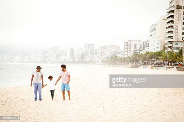 Three generation family enjoying beach, Rio de Janeiro, Brazil