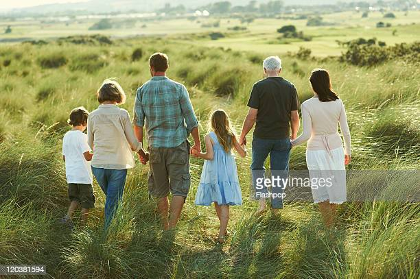 three generation family enjoying day out together - generation gap stock pictures, royalty-free photos & images