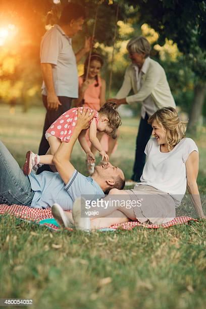 Three Generation Family Having Fun At Picnic.