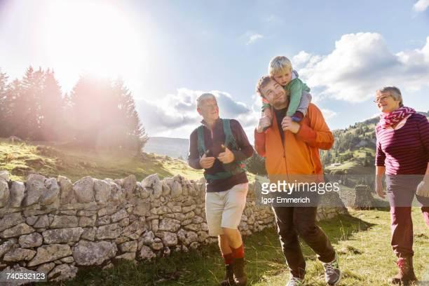 Three generation family, hiking, in rural setting, Geneva, Switzerland, Europe