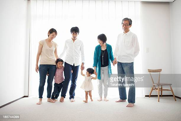 Three generation family holding hands,  portrait
