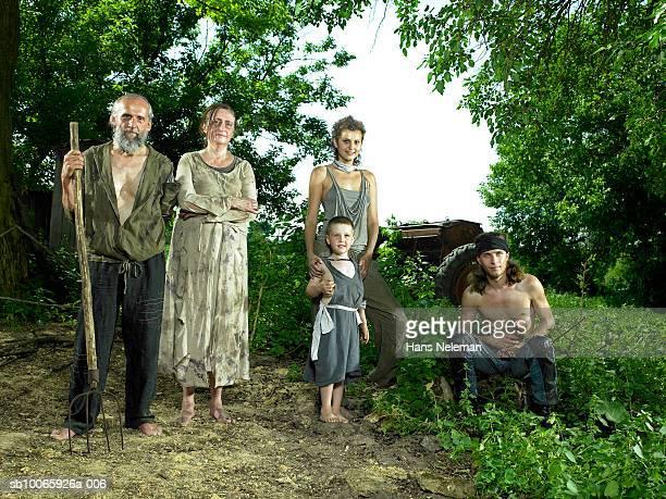 Three generation family in farm, smiling, portrait