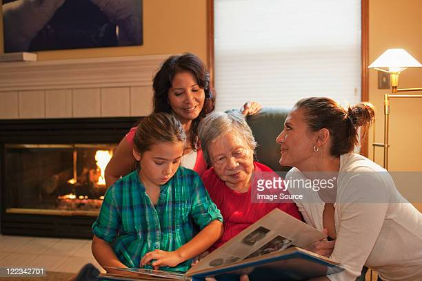Three generation family looking at photo album