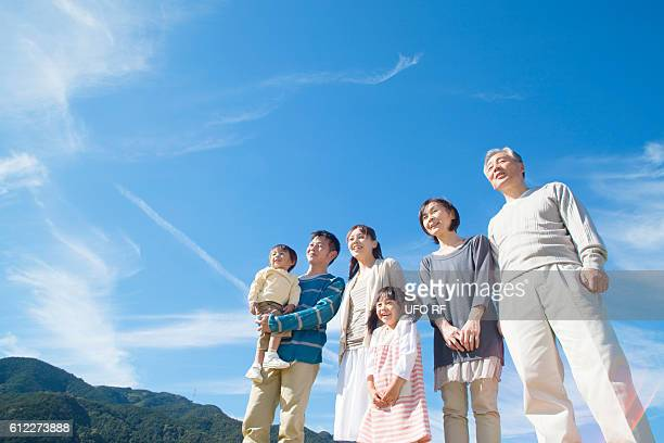 Three Generation Family Looking At View