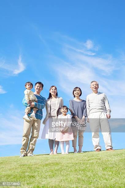 Three Generation Family on Hill