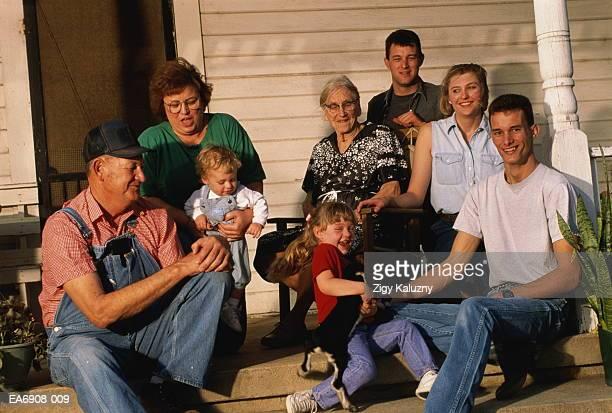 three generation family on porch - nordeuropäischer abstammung stock-fotos und bilder
