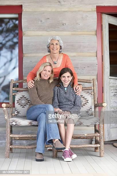 Three generation family on sofa, smiling, portrait