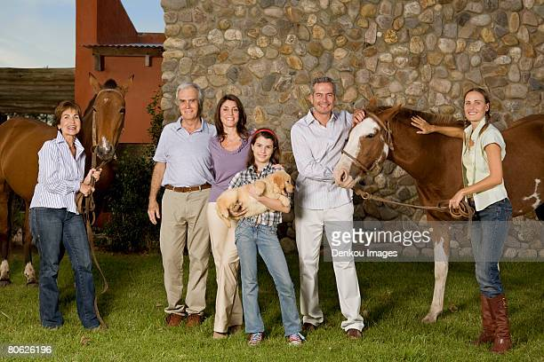 three generation family portrait with horses and puppy - casa estilo rancho fotografías e imágenes de stock