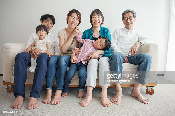 three generation family sitting on sofa,  portrait - japan mom and son stock photos and pictures
