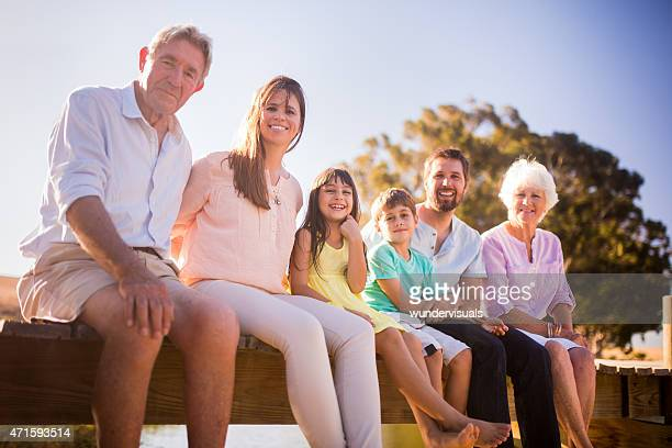 Three generation family sitting together on a summer vacation