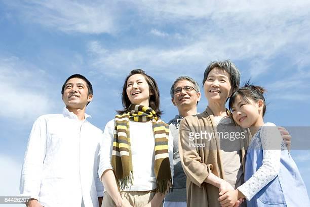 three generation family smiling, portrait - 多世代家族 ストックフォトと画像
