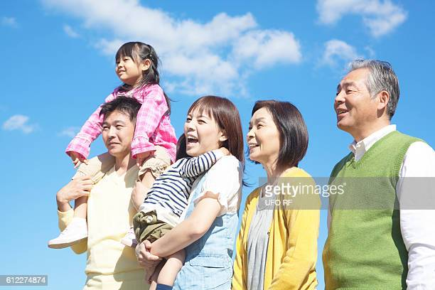 Three generation family standing