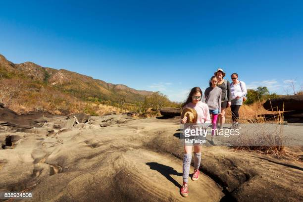 three generation family walking on vale da lua - goias stock pictures, royalty-free photos & images