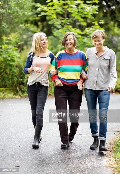 Three generation females walking on street