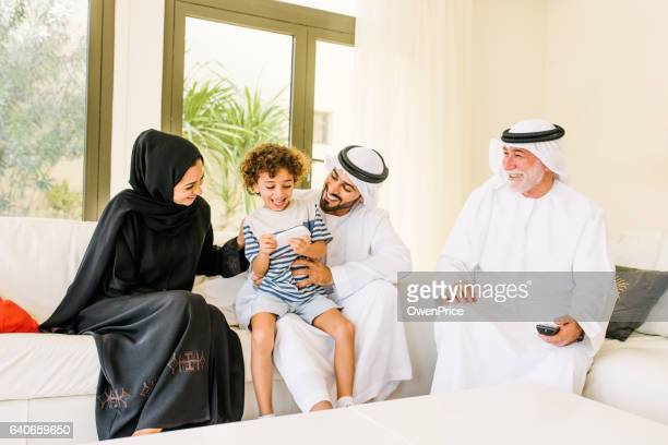 three generation happy arabic family at home - united arab emirates stock pictures, royalty-free photos & images