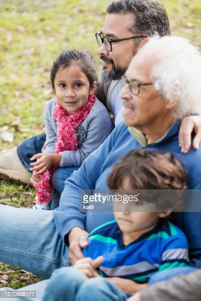 three generation hispanic family, girl looking at camera - over 80 stock pictures, royalty-free photos & images