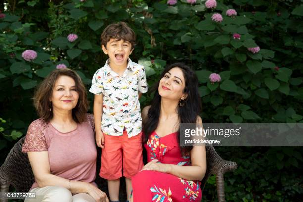 three generation persian family - iranian culture stock photos and pictures