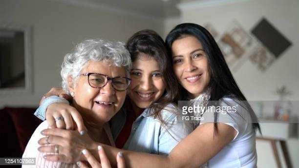 three generation women's family at home - generation gap stock pictures, royalty-free photos & images