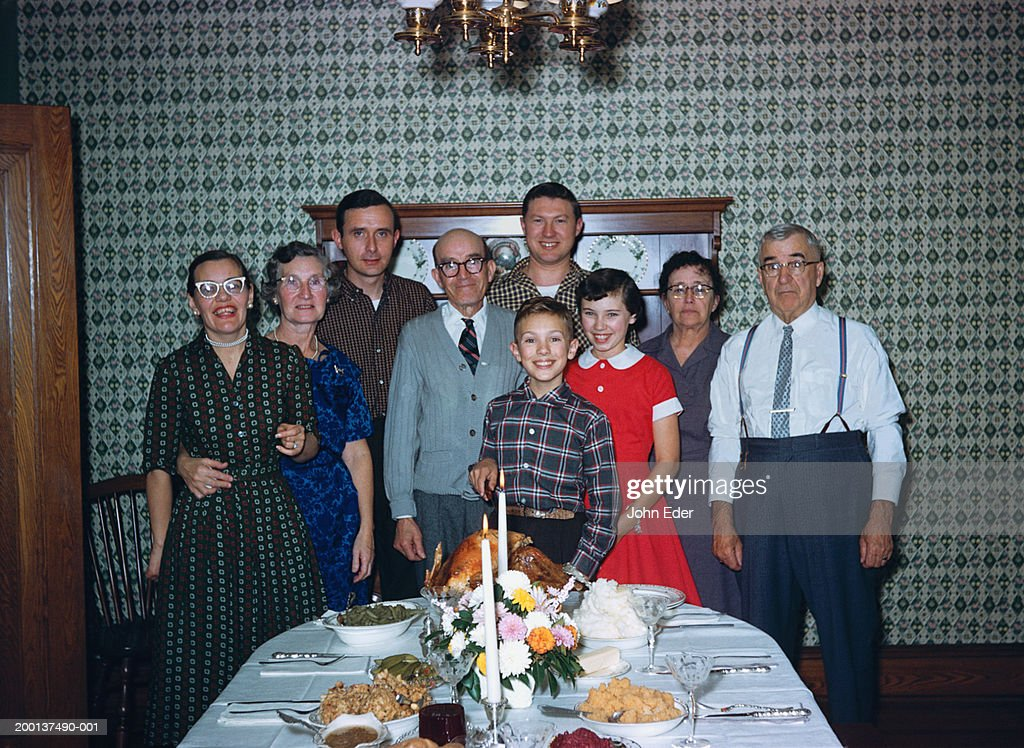 Three generational family by Thanksgiving dinner table, portrait : Stock Photo