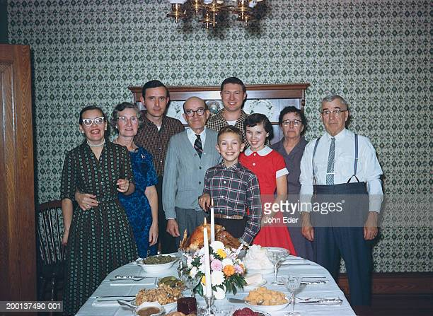 three generational family by thanksgiving dinner table, portrait - family photos stock photos and pictures