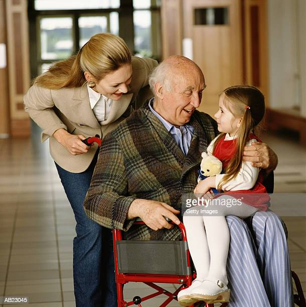 three generational family, elderly man with daughter and grandaughter - leaning disability stock pictures, royalty-free photos & images