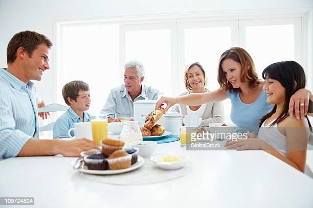 Three generational family enjoying a healthy breakfast