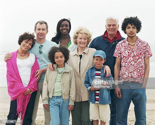 Three generational family on beach, portrait