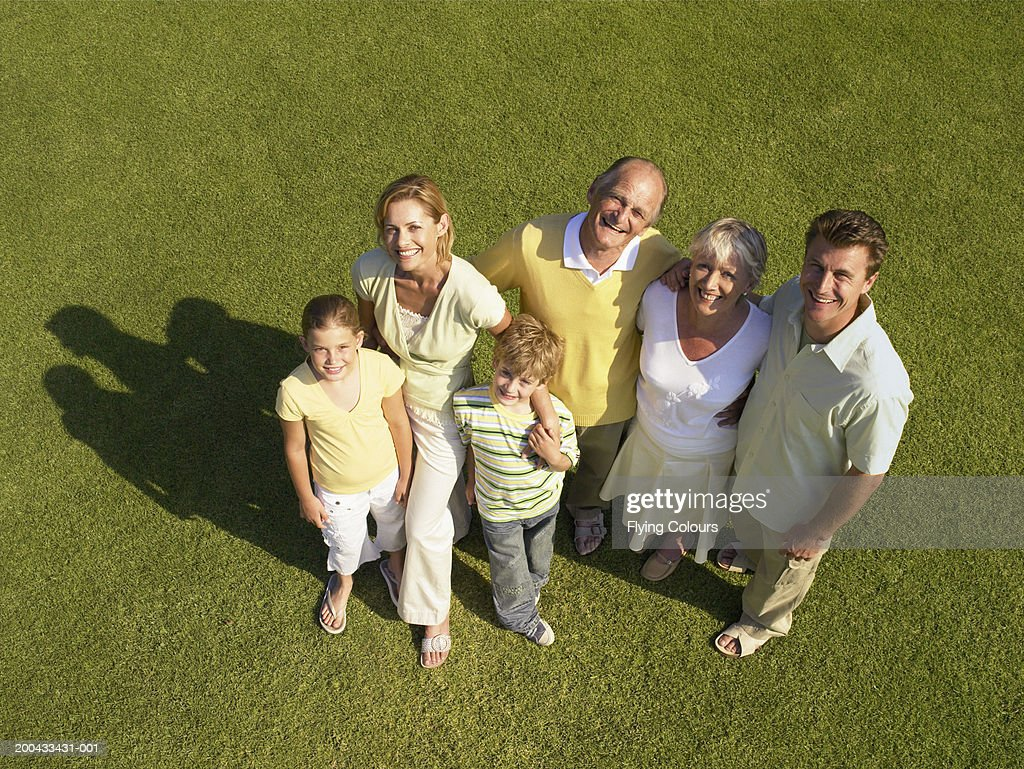 Three generational family on lawn, smiling, portrait, overhead view : Stock-Foto