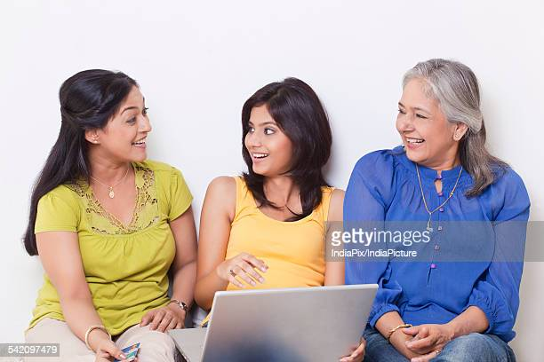 Three generational family talking while shopping online